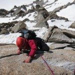 Karine on the crux of the Cosmiques Ridge