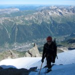 Midi-Plan Traverse - Karine with Chamonix fare below
