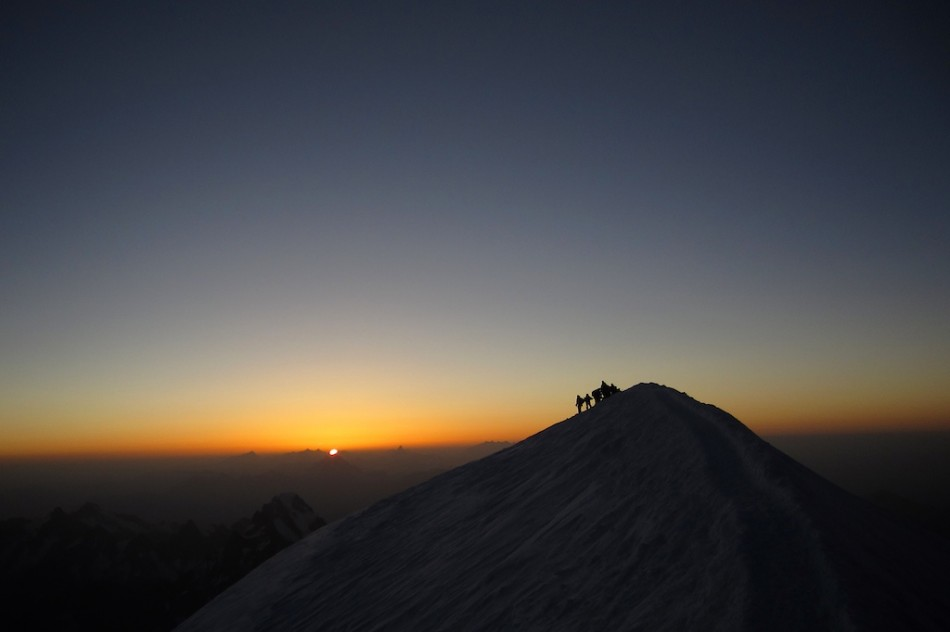 Sunrise on summit of Mont Blanc. We are already on the way down