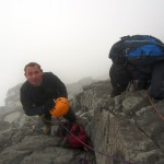 Erik taking on crampons on the Shoulder on Matterhorn
