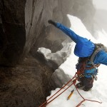 Steinar at a wet and cold belay on north-east flank on Dyrhaugstind