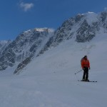 Colin skiing home with Verte, Droites and Courtes behind