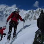 Marion and Colin on the summit of Ronde with Mt. Blanc behind