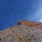 Per Magne climbing from Voie Suisses into O Sole Mio